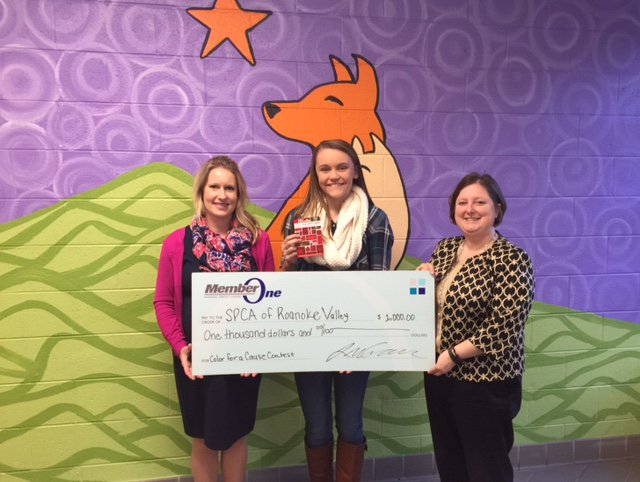 Caroline LaCroix, Community Relations Coordinator at Member One Federal Credit Union, Lexi Stull, winner of the Member One FCU Holiday Coloring for a Cause contest and Denise Hayes, Executive Director for the Roanoke Valley SPCA