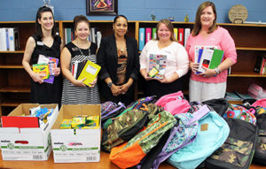 Member One staff presenting school supplies to Hurt Park Elementary School