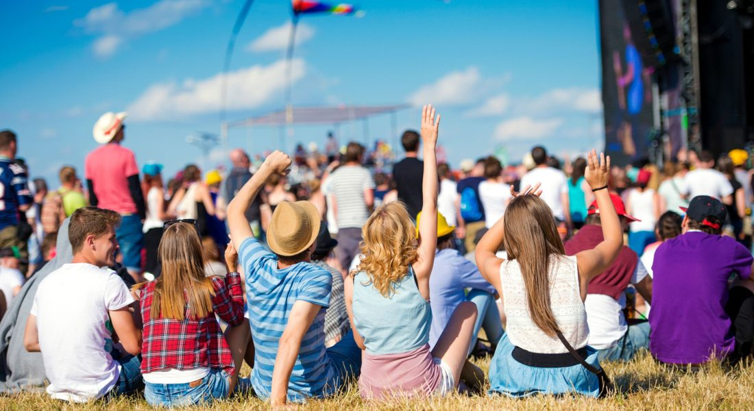 Group of people enjoying an outdoor music festival