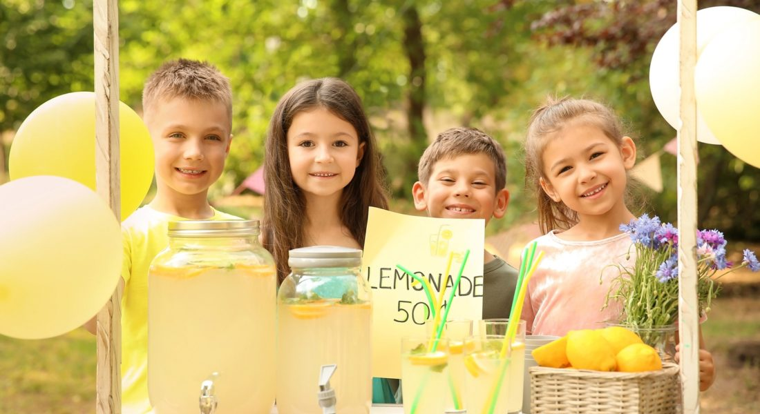 Children Work Together At Lemonade Stand