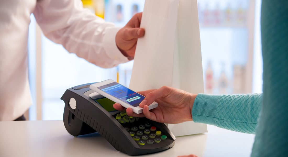 Person paying for a purchase using their smartphone