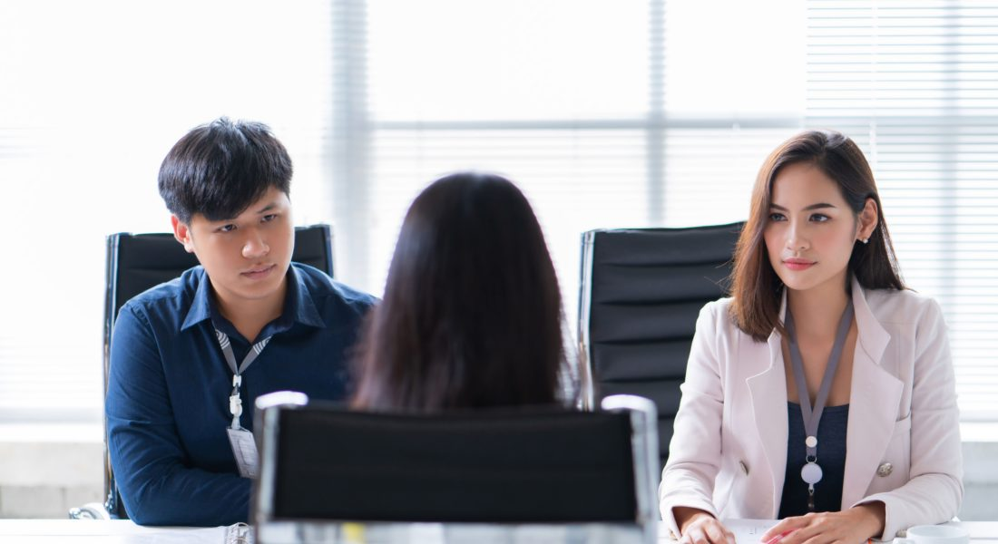 Female Job Applicant Is Interviewed In Office By Two Young Professionals
