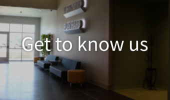 """Photo of an office with """"Get to Know Us"""" text overlay"""