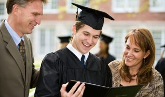 College Graduate Holding Diploma With Family