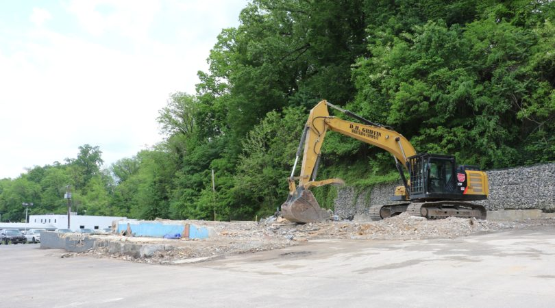 Large machinery at demolition site of new retail center.